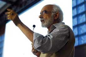 Constantino Riemma em palestra.
